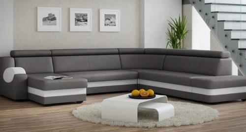 Anfield u-sofa med sovefunktion, magasin og justerbar nakkestøtte set forfra