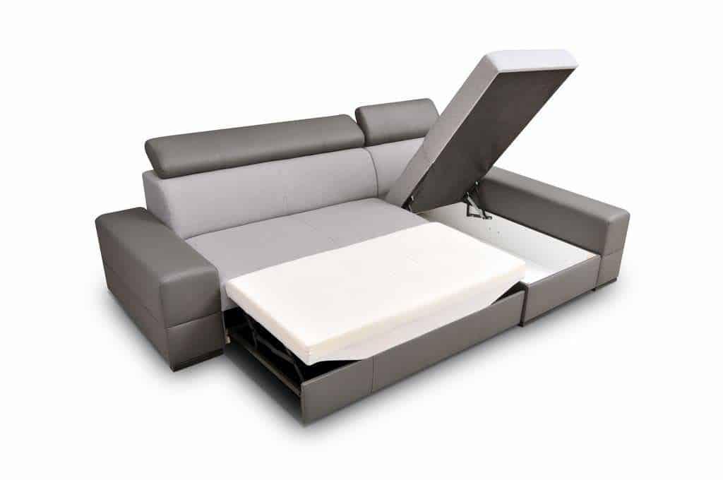 Bold chaiselong sofa med sovefunktion udført i brun og beige stof fra venstre side