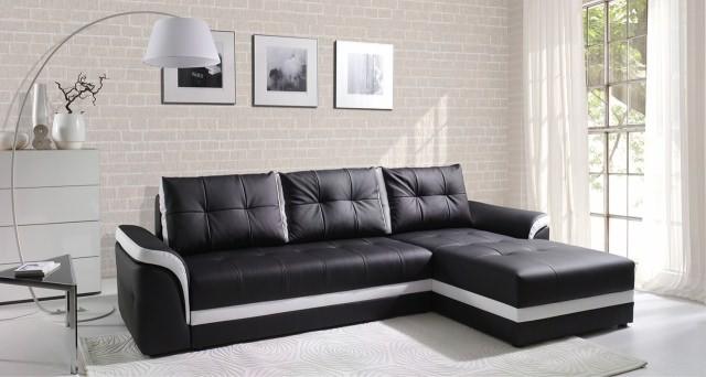 Sovesofa med chaiselong udført i sort og hvidt betræk set forfra