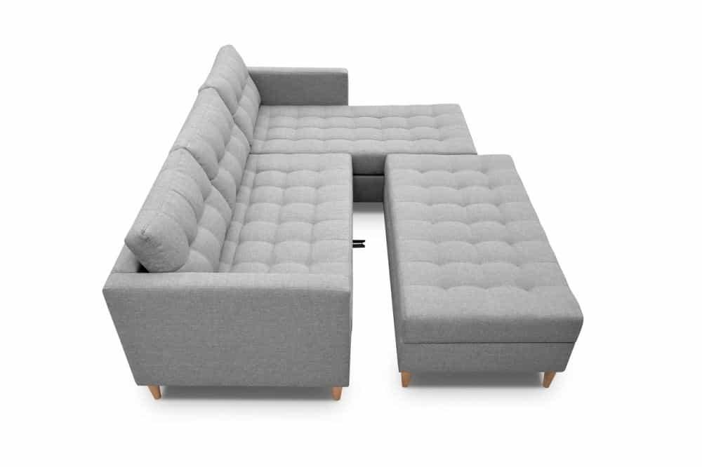 Sovesofa med chaisleong og vist beslag der samler puf med sofaen