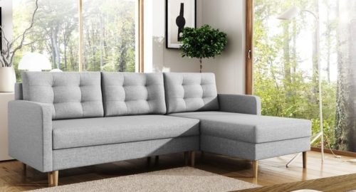 Hellen smuk sovesofa med chaiselong og opbevaring udført i grå farve set forfra